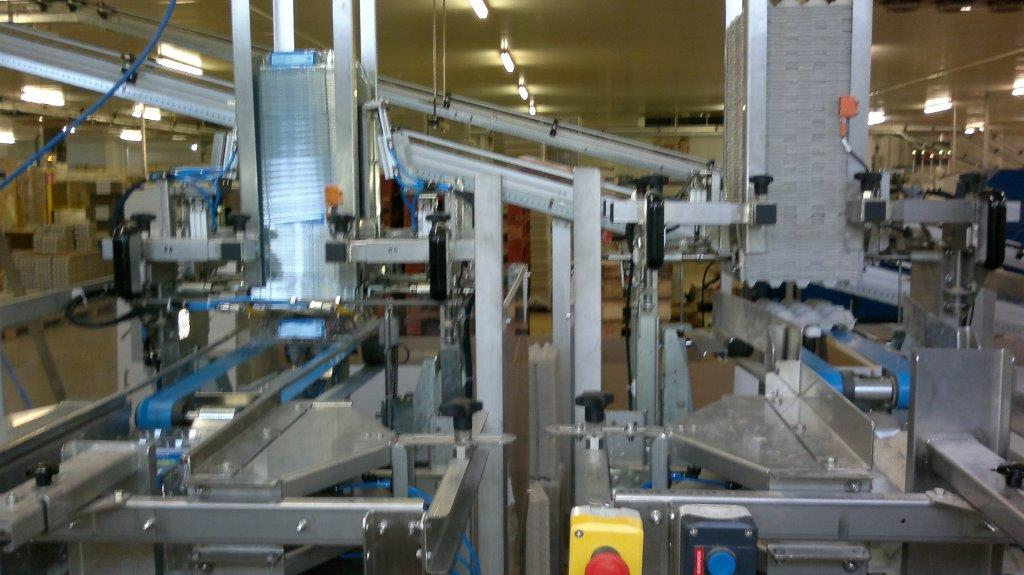 Top tray laying system